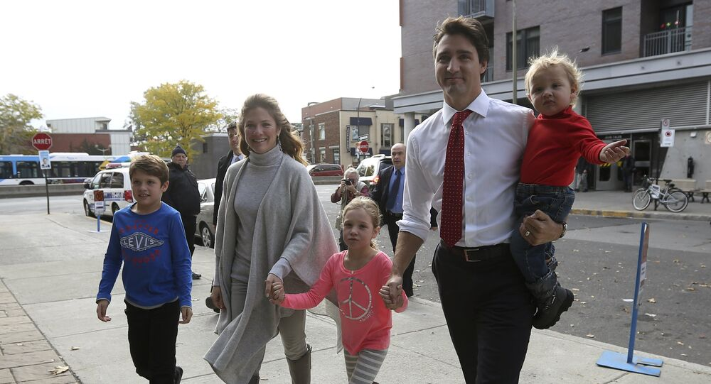 Liberal leader Justin Trudeau arrives at the polling station with his wife and children.