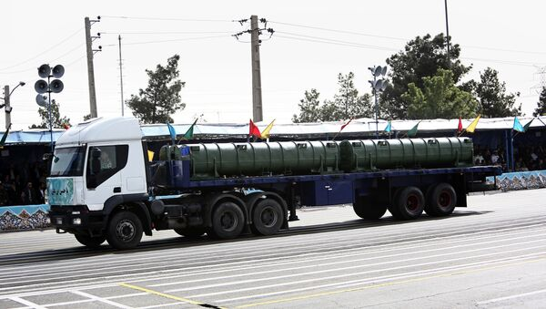An Iranian military truck carries a Bavar-373 air defence missile system during the Army Day parade in Tehran on April 18, 2015 - Sputnik International