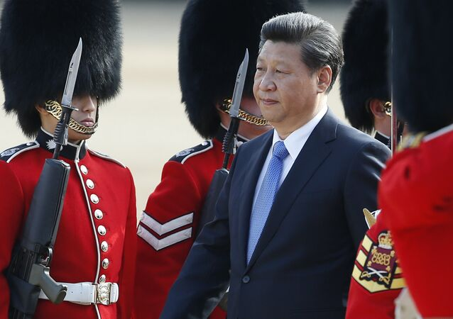 Chinese President Xi Jinping is escorted as he inspects a guard of honour during the official welcome ceremony at Horse Guards Parade in London, Tuesday, Oct. 20, 2015.