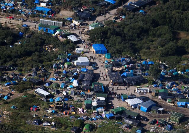An aerial view of the migrant camp known as the New Jungle Camp, near to Calais, northern France, Friday, Sept. 25, 2015.