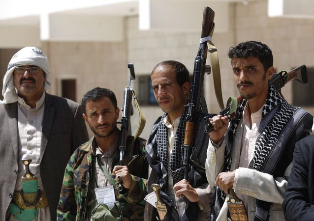 Shiite rebel fighters, known as Houthis, hold their weapons during a tribal gathering to show support for the Houthi movement in Sanaa, Yemen.