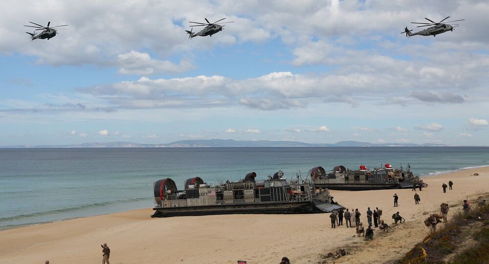 A file photo showing US navy helicopters fly over US Navy hovercraft during the NATO Trident Juncture exercise 2015.