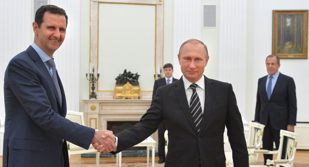 Russian President Vladimir Putin meets Syrian President Bashar Assad in the Kremlin on October 20.