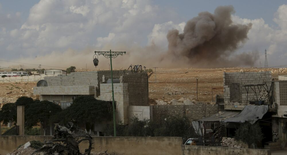 Smoke rises after what activists said were cluster bombs dropped by the Russian air force in Maaret al-Naaman town in Idlib province, Syria October 7, 2015