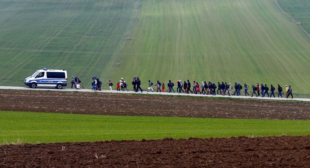 Migrants are escorted by German police to a registration centre, after crossing the Austrian-German border in Wegscheid near Passau, Germany, October 20, 2015