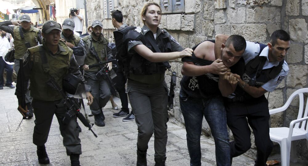 (File) Israeli policemen arrest a Palestinian man during confrontations in the Old City in Jerusalem, Wednesday, Sept. 30, 2015. Tensions over the hilltop revered by Jews as the Temple Mount and by Muslims as the Noble Sanctuary, continued Wednesday as Jews mark the Sukkot holiday