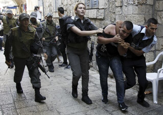Israeli policemen arrest a Palestinian man during confrontations in the Old City in Jerusalem, Wednesday, Sept. 30, 2015