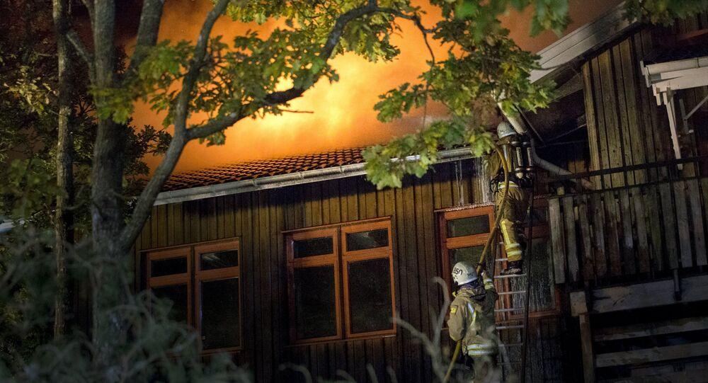Firefighters battle a fire at Furulid School in Kungsbacka, south of Goteborg, Sweden, October 18, 2015