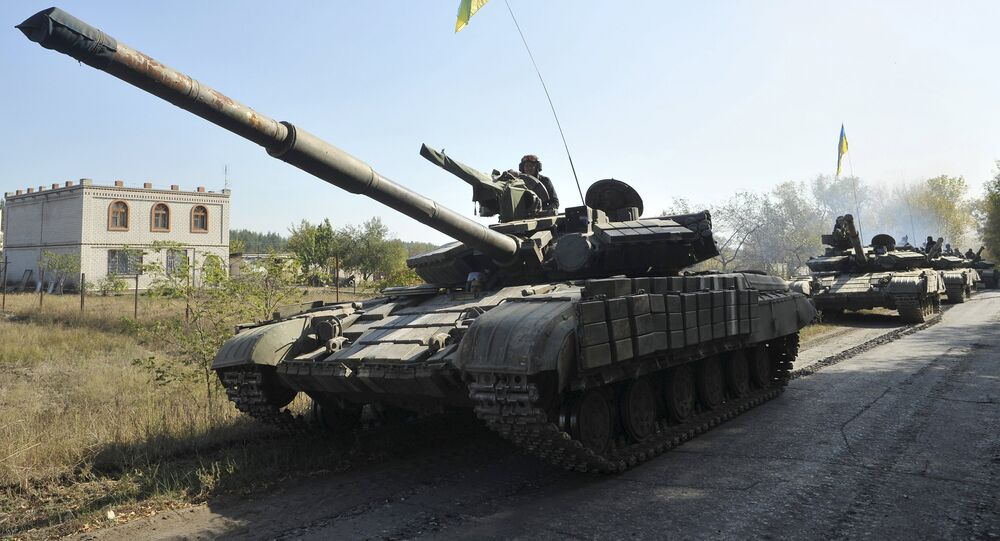 Tanks of the Ukrainian armed forces are parked on the roadside during a withdrawal near the village of Nyzhnje in Luhansk region, Ukraine, October 5, 2015