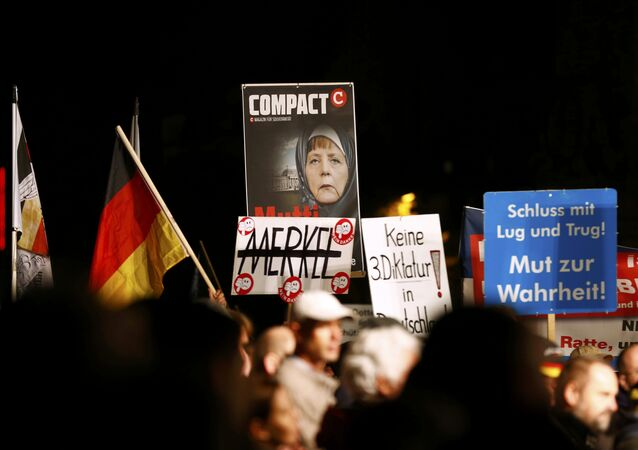 Supporters of the right-wing Alternative for Germany (AfD) demonstrate against the German government's new policy for migrants, in Erfurt, Germany October 21, 2015