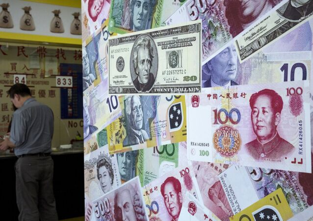 A customer is served at a counter at a foreign exchange store in Hong Kong, China