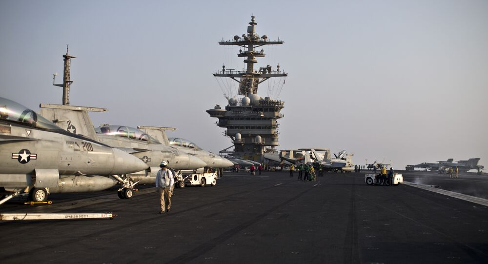 This photo shows a general view of the USS Theodore Roosevelt flight deck, Thursday, Sept. 10, 2015