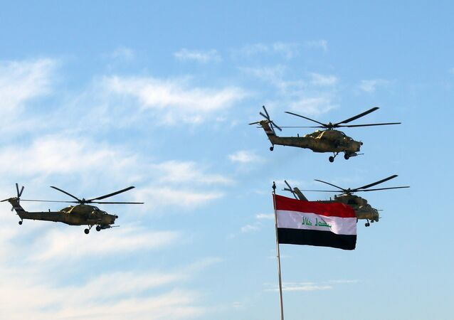 Iraqi Army helicopters fly in formation during the Army Day celebrations in Baghdad, Iraq, Tuesday, Jan. 6, 2015