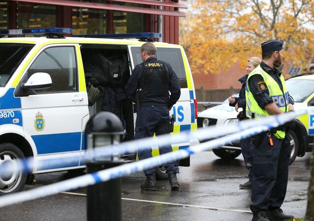 Police officers stand guard at a cordoned area after a masked man attacked people with a sword at a school in Trollhattan, western Sweden (photo used for illustration purpose)
