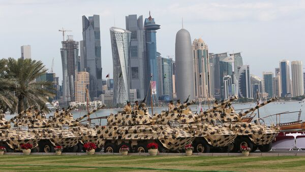 A general view show armoured vehicles rolling during the military parade marking the Gulf emirate's National Day celebrations in Doha on December 18, 2012 - Sputnik International