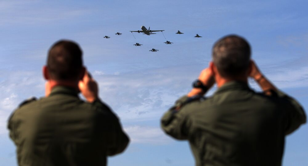 Soldiers take pictures of military aircrafts taking part in the opening ceremony of NATO's large scale exercise Trident Juncture 2015 at the Italian Air Force Base in Trapani, Sicily