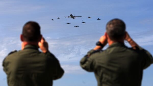 Soldiers take pictures of military aircrafts taking part in the opening ceremony of NATO's large scale exercise Trident Juncture 2015 at the Italian Air Force Base in Trapani, Sicily - Sputnik International