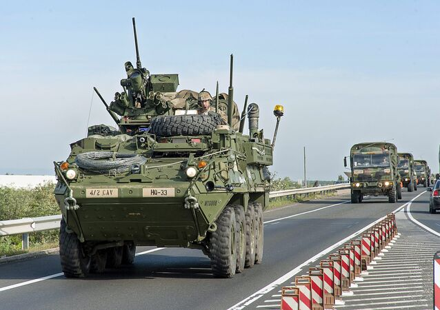 US military vehicle dirves in a convoy on the M15 motorway near Hegyeshalom, 168 km west of Budapest, Hungary, Wednesday, Sept. 16, 2015, a day prior to the NATO Brave Warrior 2015 international military exercise