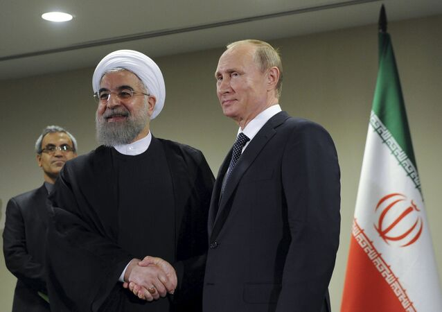 Russia's President Vladimir Putin (R) meets with Iran's President Hassan Rouhani on the sidelines of the United Nations General Assembly in New York, September 28, 2015