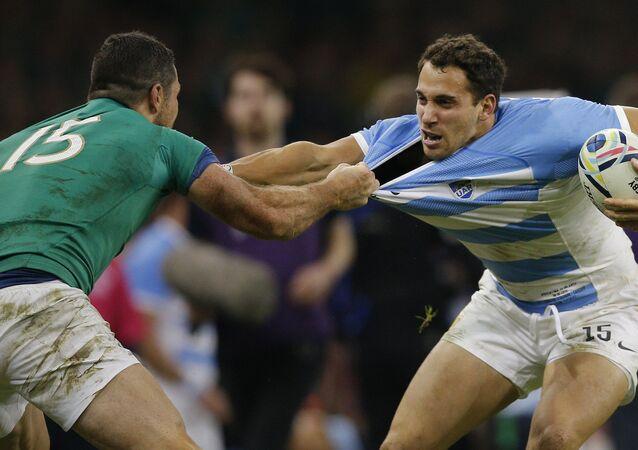 Ireland's Rob Kearney, left, grabs the shirt of Argentina's Joaquin Tuculet