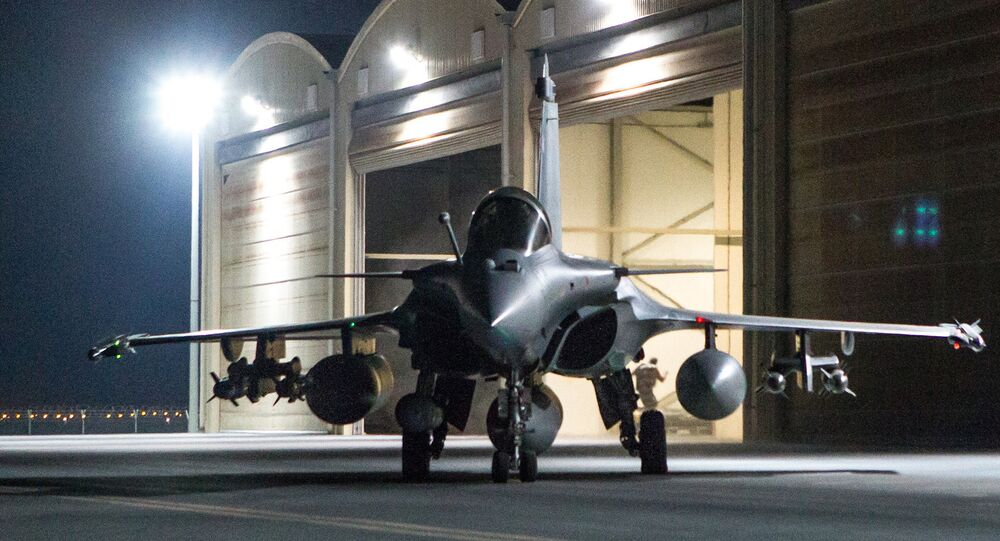 This photo released on Friday, Oct. 9, 2015 by the French Army Communications Audiovisual office (ECPAD) shows a French army Rafale fighter jet on the tarmac of an undisclosed air base as part of France's Operation Chammal launched in September 2015 in support of the US-led coalition against Islamic State group