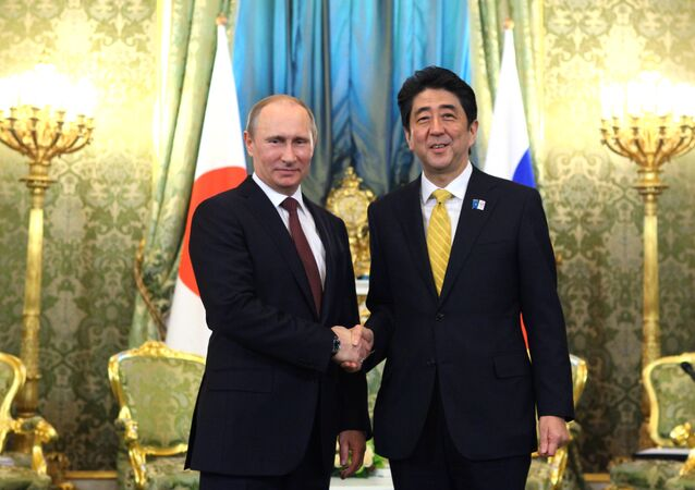 Russian President Vladimir Putin and Prime Minister of Japan Shinzo Abe shake hands prior to their talks in the Kremlin, April 29, 2013