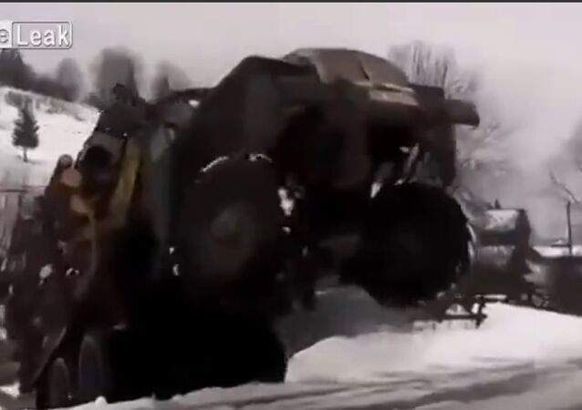 A fully-loaded URAL truck shows acrobatic stunts on a snowy Siberian road.