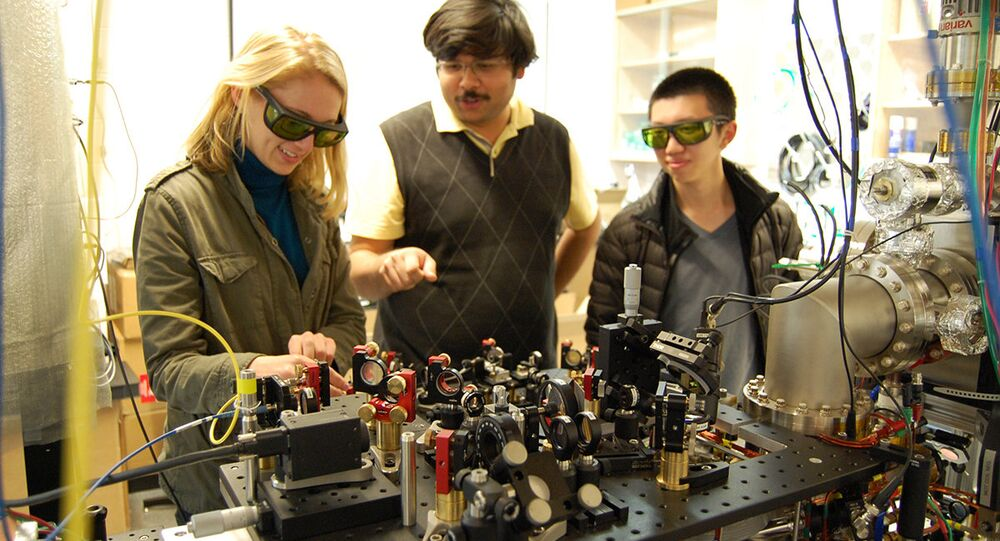 Cornell University graduate students Airlia Shaffer, Yogesh Patil and Harry Cheung work in the Ultracold Lab of Mukund Vengalattore, assistant professor of physics.