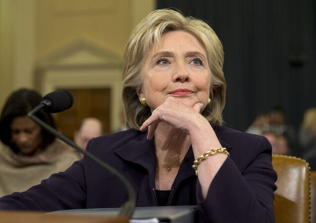 Democratic presidential candidate and former Secretary of State Hillary Rodham Clinton, listens as she testifies on Capitol Hill in Washington, Thursday, Oct. 22, 2015, before the House Select Committee on Benghazi