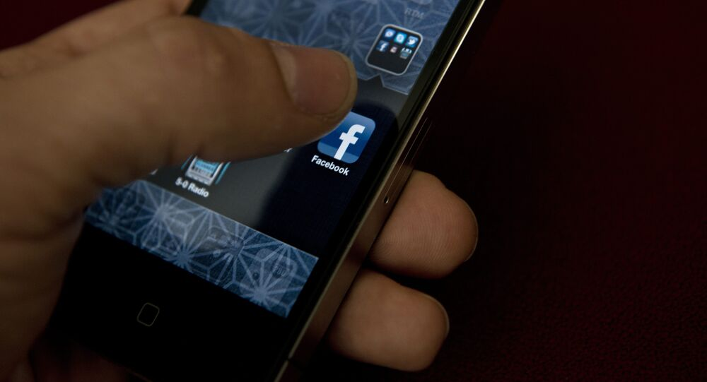 A view of and Apple iPhone displaying the Facebook app's splash screen May 10, 2012 in Washington, DC