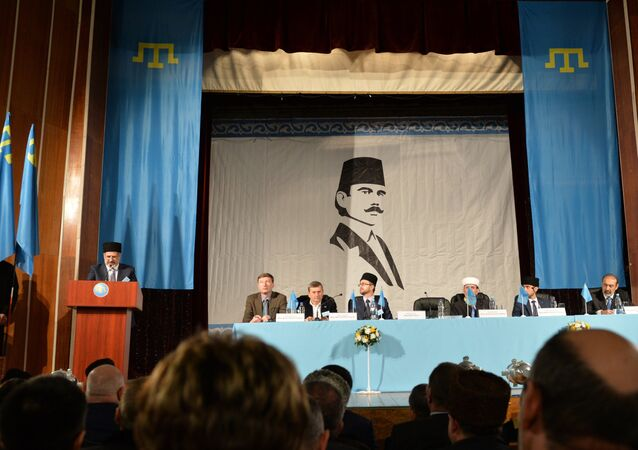 Head of Mejlis of Crimean Tatar people Refat Chubarov, left, at the rostrum, speaks at an extraordinary session of the Kurultay (meeting) of the Crimean Tatar People in Bakhchysarai
