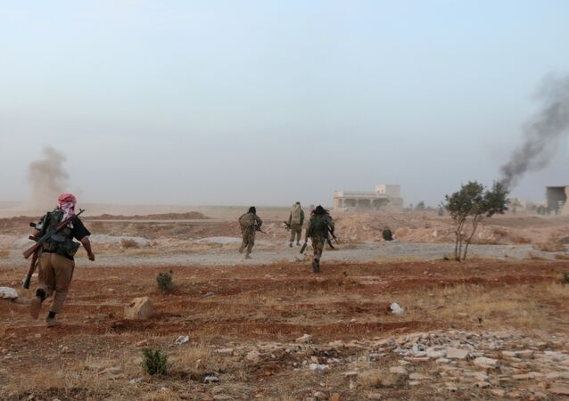 Syrian opposition fighters run in the Mount Azzan area, 24 kms from the northern Syrian city of Aleppo, during reported fighting against forces loyal to Syrian President Bashar al-Assad