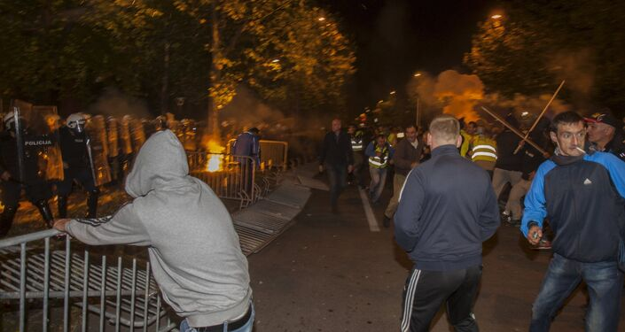 Protesters remove barricades during clashes with police in front of the parliament building in Podgorica, Montenegro, October 24, 2015.
