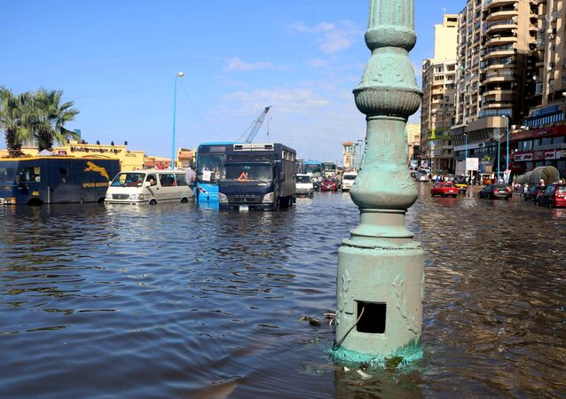 Cars and buses are seen in a main street after heavy rainfall in Alexandria, Egypt, October 25, 2015.