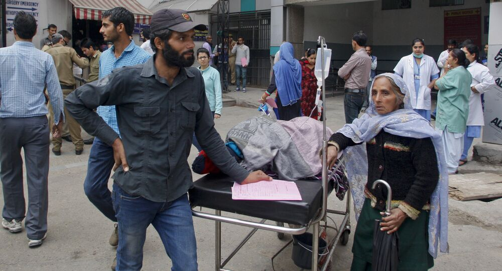 Patients who were shifted outdoors at the government medical college hospital after a strong tremor was felt in Jammu, India