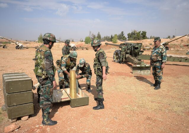 Crews of 130 mm guns of the 10th Division, 2nd Corps of the Syrian Arab Army are deployed off Katana, Damascus Province