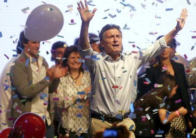 Mauricio Macri, presidential candidate of Cambiemos (Let's Change) coalition waves to his supporters after election in Buenos Aires, Argentina, October 25, 2015.