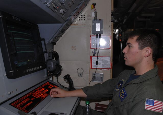 Naval Air Crewman (Operational Level) 2nd Class Roberto Hernandez, assigned to Patrol Squadron (VP) 9, analyzes sonobuoy information during a preflight check aboard a P-3 Orion aircraft at Misawa Air Base. VP-9 is on a deployment in the U.S. 7th Fleet area of responsibility.