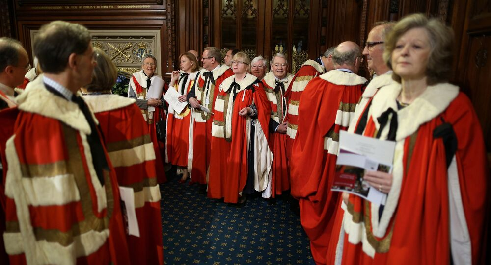 Members of The House of Lords wait in the Prince's Chamber before entering the Chamber of the House of Lords for the State Opening of Parliament at the Palace of Westminster in London on May 9, 2012.