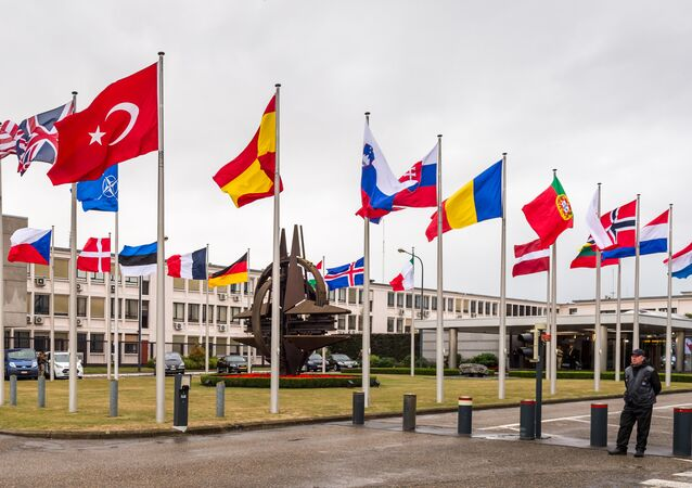 NATO country flags wave outside NATO headquarters in Brussels