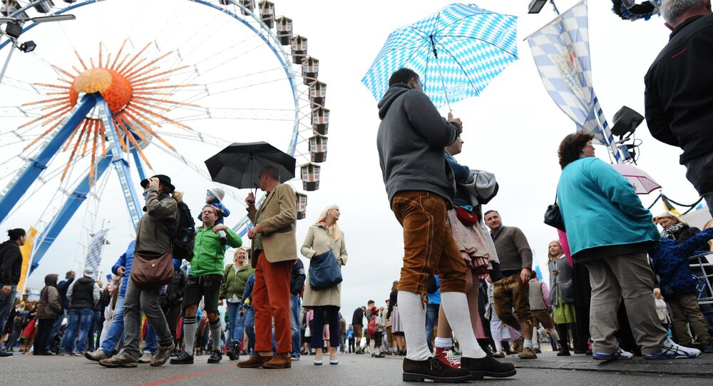 Visitors walk at the venue of the the annual Oktoberfest beer festival on October 04, 2015 in Muenchen.