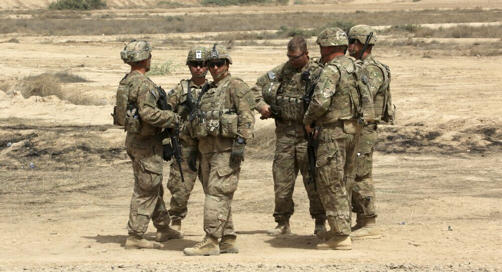 U.S. soldiers prepare to participate in a training mission with Iraqi Army soldier, right, outside Baghdad, Iraq. (File)