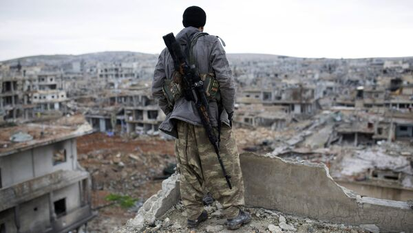 FILE - In this Jan. 30, 2015, file photo, a Syrian Kurdish sniper looks at the rubble in the Syrian city of Ain al-Arab, also known as Koban - Sputnik International