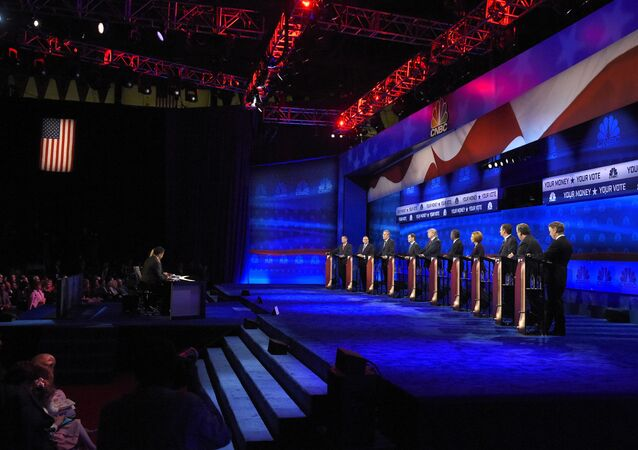 Republican presidential candidates, from left, John Kasich, Mike Huckabee, Jeb Bush, Marco Rubio, Donald Trump, Ben Carson, Carly Fiorina, Ted Cruz, Chris Christie, and Rand Paul take the stage during the CNBC Republican presidential debate at the University of Colorado, Wednesday, Oct. 28, 2015, in Boulder, Colo