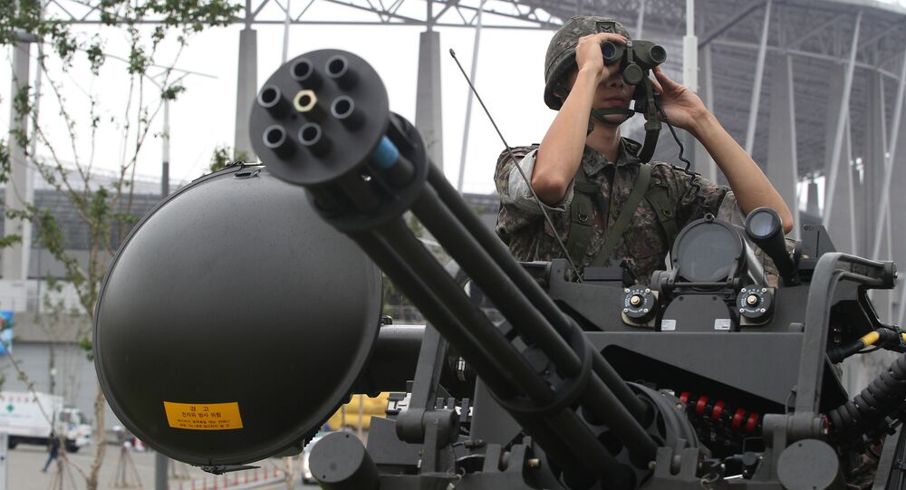 A South Korean army soldier uses a pair of binoculars during an anti-terror drill ahead of the 2014 Incheon Asian Games outside of Incheon Asiad Main Stadium in Incheon, South Korea, Wednesday, Aug. 6, 2014