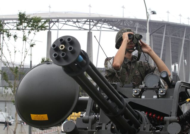 A South Korean army soldier uses a pair of binoculars during an anti-terror drill ahead of the 2014 Incheon Asian Games outside of Incheon Asiad Main Stadium in Incheon, South Korea, Wednesday, Aug. 6, 2014.