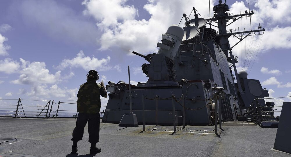 SOUTH CHINA SEA (Sept. 16, 2015) Gunner's Mate Seaman Brenda Algado from Dallas, Texas observes a live-fire exercise with a close-in weapon system (CWIS) aboard the Arleigh Burke-class guided-missile destroyer USS Lassen (DDG 82)