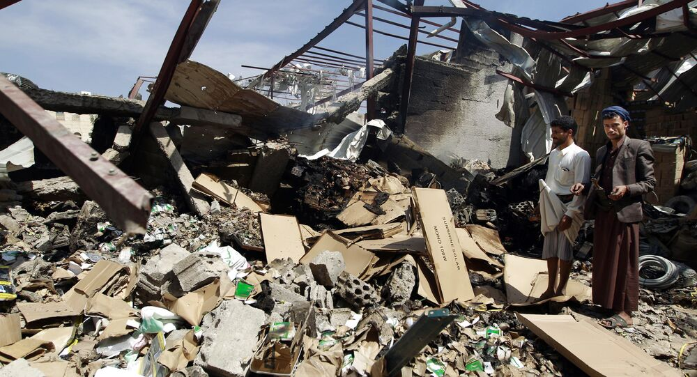 Workers inspect the rubble of a food storage warehouse destroyed by a Saudi-led airstrike in Sanaa, Yemen, Monday, Oct. 26, 2015