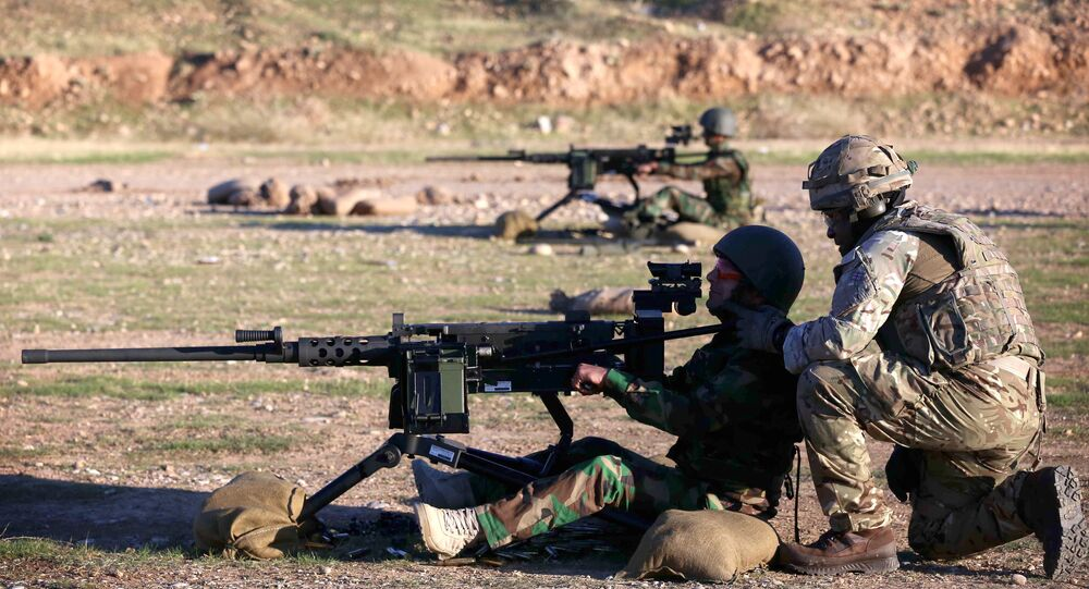 Military advisers instruct Kurdish Peshmerga fighters during a training session at a shooting range on the outskirts of Arbil, the capital of the autonomous Kurdish region of northern Iraq on November 5, 2014