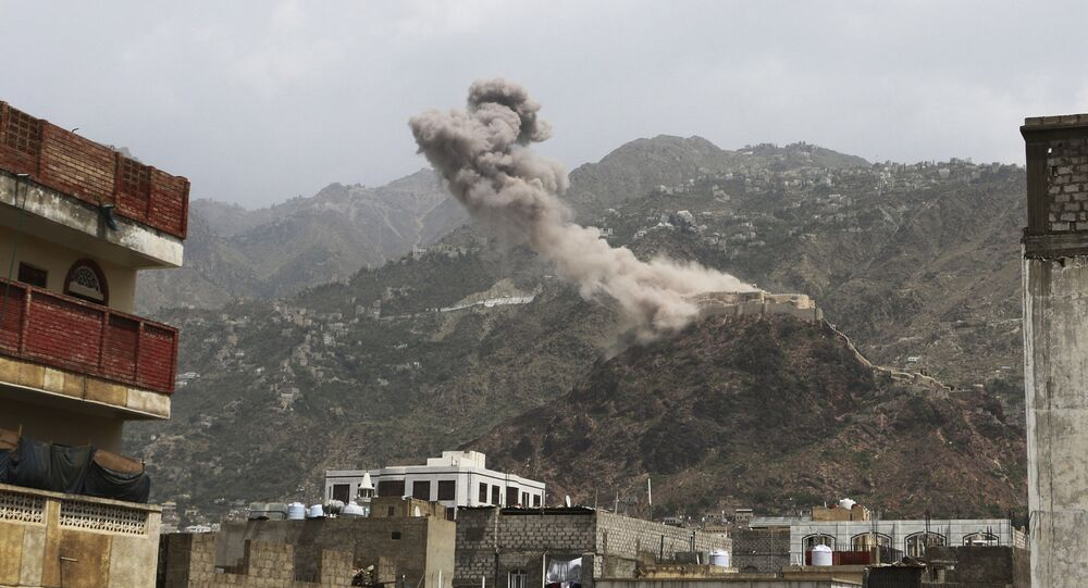 File photo of smoke rises from al-Qahira castle, an ancient fortress that was recently taken over by Shiite rebels, following a Saudi-led airstrike in Taiz city, Yemen, Thursday, May 21, 2015